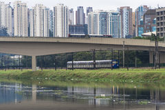Pinheiros river. SAO PAULO, BRAZIL, JUNE 01, 2008. Pollution of Pinheiros river by sewage and trash of city in a rain day stock photos