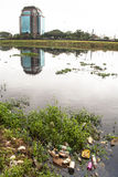Pinheiros river. SAO PAULO, BRAZIL, JUNE 01, 2008. Pollution of Pinheiros river by sewage and trash of city in a rain day royalty free stock photography