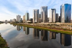 View of Marginal Pinheiros with modern buildings. Pinheiros  river in Sao Paulo, Brazil, with modern buildings and their reflections in the water royalty free stock photo