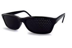 Pinhole glasses Stock Photo