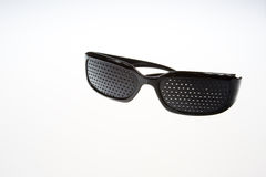 Pinhole Glasses on isolated white Royalty Free Stock Images