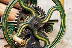 Pinion gear with wheel of old mechanical  device Royalty Free Stock Photo