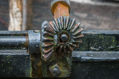 The pinion gear with wheel of an old mechanical  device Royalty Free Stock Image