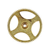Pinion macro. Clockwork brass pinion macro closeup isolated on white background Stock Images