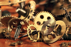 Pinions. Some brass gears and a pendulum from old hours Royalty Free Stock Photos