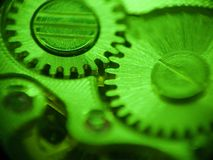 Pinions. In green light macro Royalty Free Stock Photos