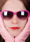 Pink. Portrait of a young lady wearing pink sunglasses Stock Images