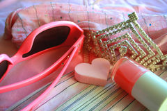 Pink accessories. Pink things for the girl. Glasses, a varnish, clothes, a diadem Royalty Free Stock Photos