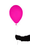 Pink air balloon in hand Royalty Free Stock Photography