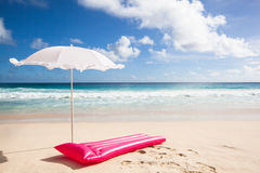 Pink air mattress and white sunshade Stock Photo
