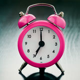 Pink Alarm clock close up Royalty Free Stock Images