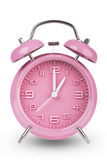 Pink alarm clock with hands at 1 am or pm isolated on white background Stock Images