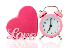 Pink alarm clock and  heart shape gift box Stock Images