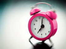 Pink Alarm clock ringing Stock Photos