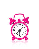 Pink alarm clock on white background Stock Image