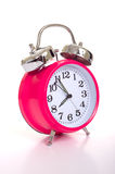 A pink alarm clock on a white background Stock Images