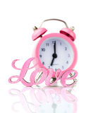 Pink alarm clock and the word Royalty Free Stock Image