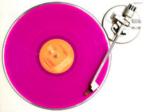 The pink album. Pink vinyl record, turning on a recordplayer stock image