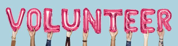 Pink alphabet balloons forming the word volunteer stock photo
