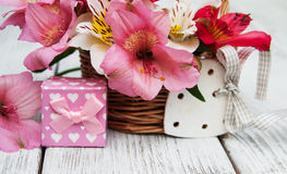 Pink alstroemeria with gift box Stock Photos