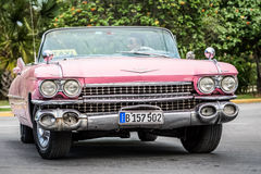 Pink  american classic cabriolet  car on the street in Santa Clara Cuba Stock Photos