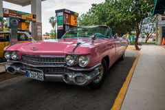 Pink american vintage car on the gas station in Havana Cuba Royalty Free Stock Photo