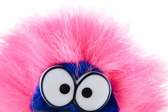 Pink and amusing. Toy with pink fur removed on a white background Stock Photo
