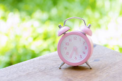 The pink analog alarm clock Royalty Free Stock Photo