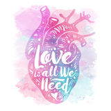 Pink anatomical heart on Watercolor background. Tagline love is all we need. Valentines day card. Vector illustration Stock Photos