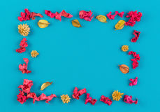 Free Pink And Yellow Dried Flower Plants Rectangular Border Frame On Blue Background. Top View, Flat Lay. Royalty Free Stock Photography - 87127497
