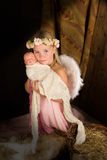 Pink angel in nativity scene Royalty Free Stock Photos