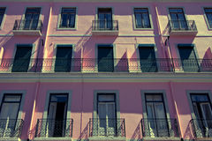 Pink apartment buildings in Lisbon, Portugal. Lovely apartment buildings in Lisbon, Portugal stock photo