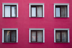 Pink apartment and windows. Pink building and six windows Royalty Free Stock Photography