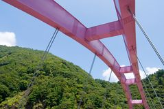 Pink arch bridge. Under blue sky Stock Photography