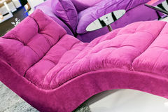 Pink armchair. Pink and comfort armchair for livingroom on the carpet Stock Photo