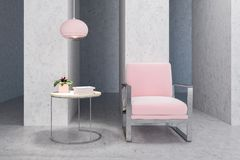 Pink armchair in empty concrete living room, table Royalty Free Stock Photos