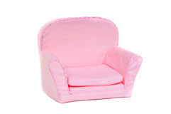 Pink armchair isolated on white background. Small pink armchair with pillows on it isolated on white background Stock Images