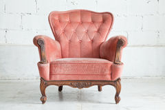 Pink Armchair sofa. Pink classical style Armchair sofa couch in vintage room Royalty Free Stock Photography