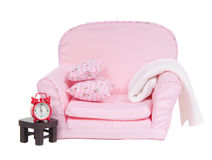 Pink armchair, table and alarm clock isolated. Pick armchair with tiny table and red alarm clock isolated on white background Stock Photos