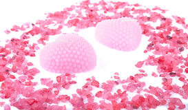 Pink aroma candles decorated with bath salt Royalty Free Stock Photography