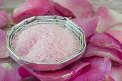 Pink aromatic bath in a bowl salt on a table decorated with rose Stock Photo