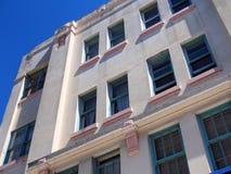 Pink Art Deco Building Façade. Pink art deco building facade, blue window frames stock photography