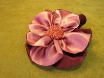 Pink artificial fabric flower Royalty Free Stock Images