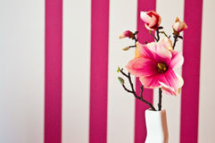 Pink artificial flower as room decoration Stock Photos