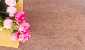 Pink artificial flower on wood Royalty Free Stock Photo