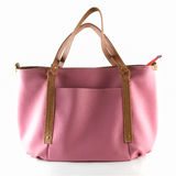 Pink artificial leather bag Stock Photo