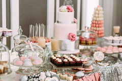 Pink assortie of the cakes and cupcakes Royalty Free Stock Image