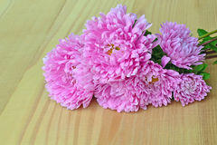 Pink aster flowers. Bouquet of pink aster flowers on wooden tabletop Stock Photo