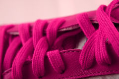 Pink athletic shoe laces. A closeup view of the top of a pink athletic shoe with matching pink laces Royalty Free Stock Photography