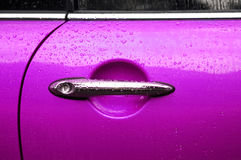 Pink auto door. Raindrops on a pink auto door Stock Images
